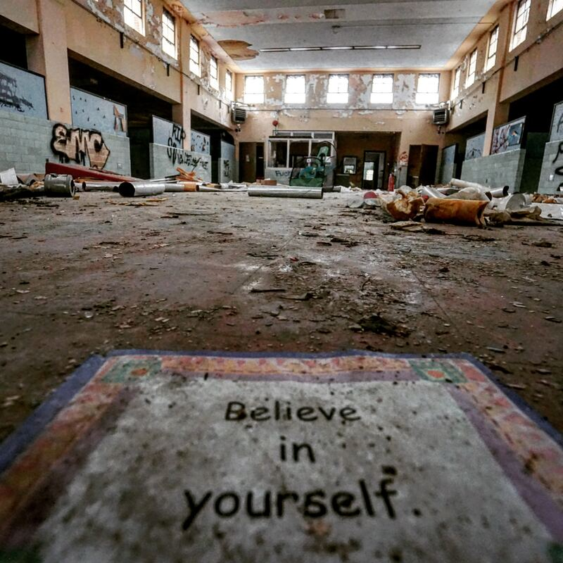 Inspirational saying in an abandoned building